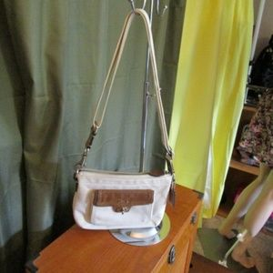 Coach Swingpack Pocket Crossbody purse.